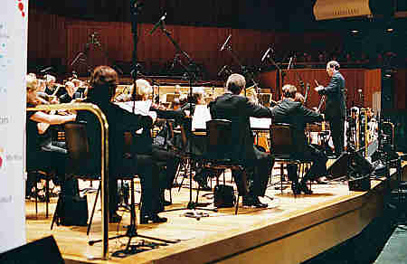 an analysis of the performance of the bbc symphony orchestra Orchestral music is written in the form of a score, which shows the notes that are played by each instrument every musician only sees the notes that the string section is the most important part of a symphony orchestra it has more than half of the musicians and consists of violins, violas , cellos.